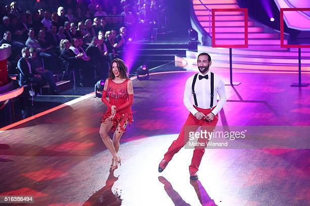 Jana Pallaske and Massimo Sinato perform on stage during the 2nd show of the television competition 'Let's Dance' on March 18 2016 in Cologne Germany