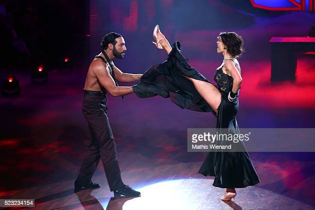 Jana Pallaske and Massimo Sinato perform on stage during the 6th show of the television competition 'Let's Dance' on April 22 2016 in Cologne Germany