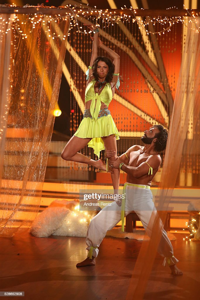 Jana Pallaske and Massimo Sinato perform on stage during the 8th show of the television competition 'Let's Dance' on May 6, 2016 in Cologne, Germany.