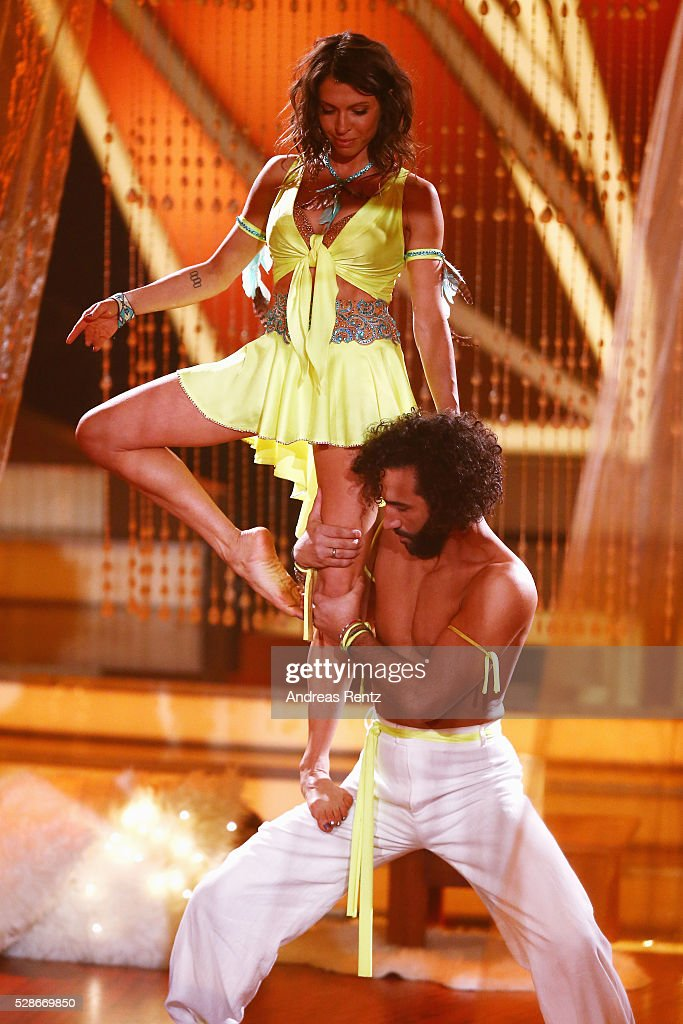 Jana Pallaske and Massimo Sinato perform on stage during the 8th show of the television competition 'Let's Dance' on May 06, 2016 in Cologne, Germany.