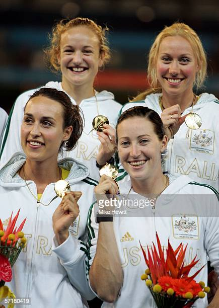 Jana Pitman Caitlin Willis Tamsyn Lewis and Rosemary Hayward pose for a picture during the medal ceremony for the womens 4x400 metre relay final at...