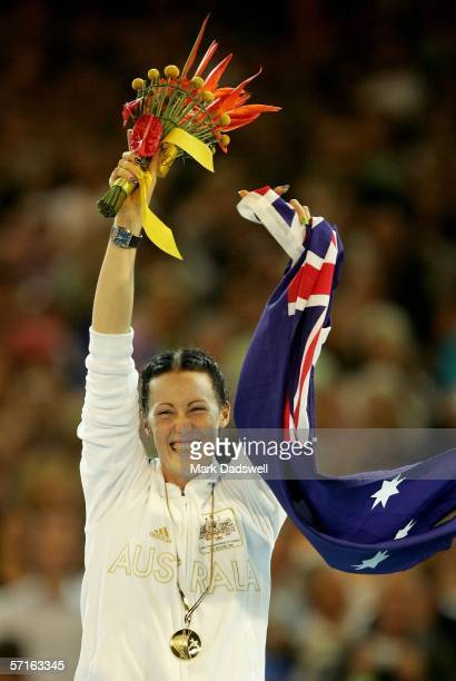 Jana Pittman of Australia celebrates during the medal ceremony for the women's 400 metre final at the athletics during day eight of the Melbourne...