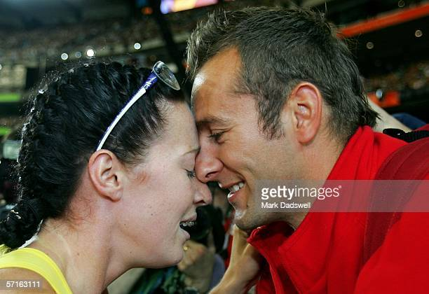 Jana Pittman of Australia celebrates with partner Chris Rawlinson after winning the women's 400 metre Hurdles final at the athletics during day eight...