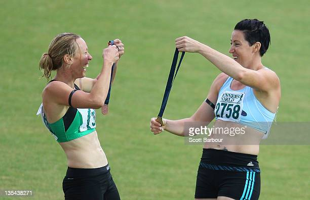 Jana Pittman of Glen Huntly and Tamsyn Lewis of Sandringham share a joke after the medal presentation for the Victorian 4x400m Womens Final during...