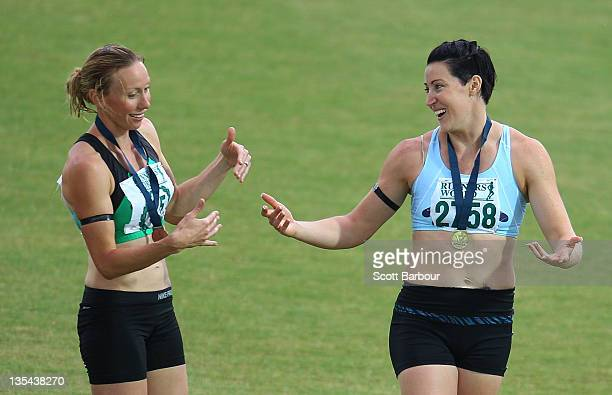 Jana Pittman of Glen Huntly and Tamsyn Lewis of Sandringham talk after the medal presentation for the Victorian 4x400m Womens Final during the 2011...