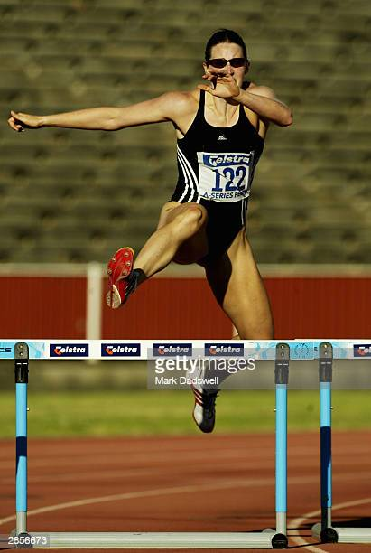 Jana Pittman of the VIS clears the last hurdle in the Mixed 330 Metres Hurdles Demonstration event during the Telstra A Series meeting at Perry Lakes...