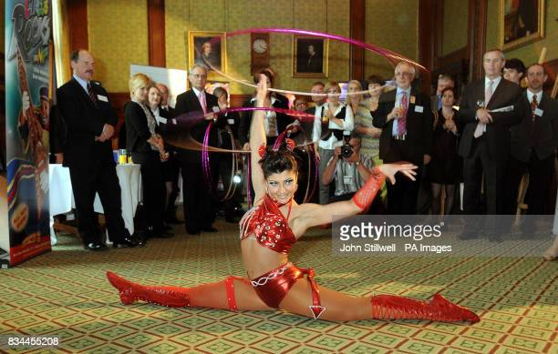 Jana Roberts from the Blackpool Tower Circus performs for MPs in the MP's dinning room at the Houses of Parliament
