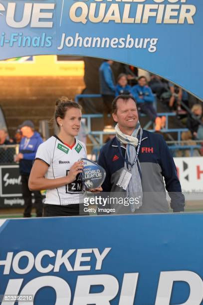 Jana Teschke of Germany receives the trophy from Jason McCracken FIH Chief Executive during day 9 of the FIH Hockey World League Women's Semi Finals...