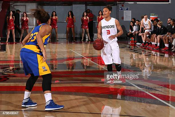 Janae Sharpe of the Cal State Northridge Matadors dribbles the ball against Brittany Crain of the UC Riverside Highlanders in the first half of the...