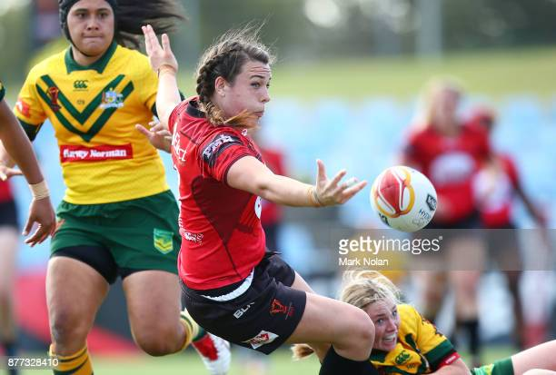 Janai Haupapa of Canada offloads during the Women's Rugby League World Cup match between the Canadian Ravens and the Australian Jillaroos at Southern...