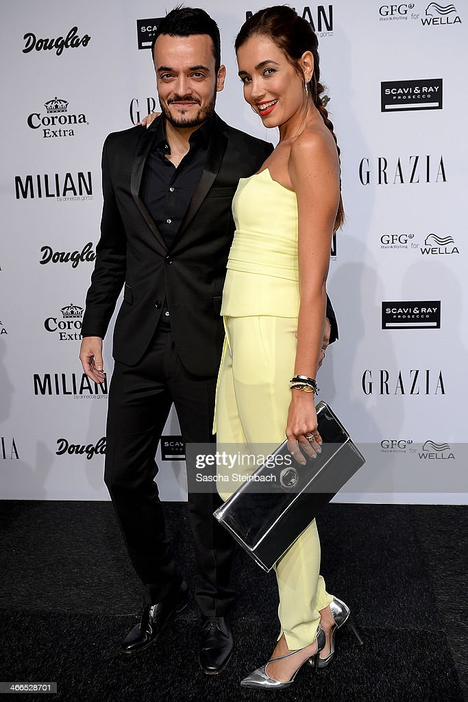 Jana-Ina Zarrella (R) and Giovanni Zarrella (L) attend the Milian by Annette Goertz show during Platform Fashion Dusseldorf on February 1, 2014 in Dusseldorf, Germany.