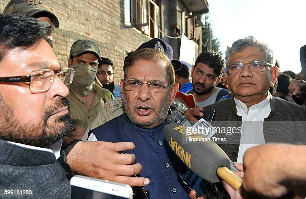 Janata Dal Party leader Sharad Yadav talking to media persons outside the residence of senior separatist leader of the hardliner faction of All...