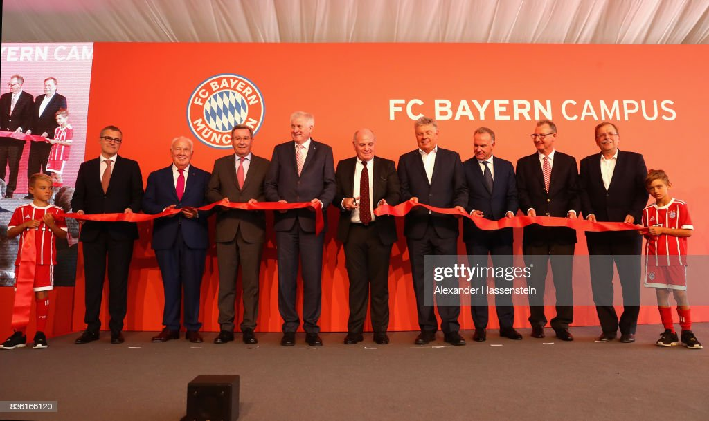 Jan-Christian Dreesen, COO of FC Bayern Muenchen, Walter Mennekes, Vice-President of FC Bayern Muenchen, Karl Hopfner, Horst Seehofer, Bavarian Governor, Uli Hoeness, President of FC Bayern Muenchen, Dieter Reiter, Lord Major of Muenchen, Karl-Heinz Rummenigge, CEO of FC Bayern Muenchen, Dieter Mayer, Vice-President of FC Bayern Muenchen and Rainer Koch, President of Bavarian Football Association attend the ribbon cut during the opening ceremony of the FC Bayern Campus at FC Bayern Campus on August 21, 2017 in Munich, Germany.