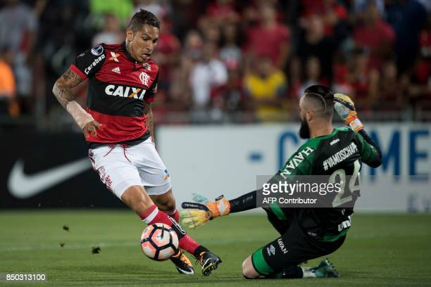 Jandrei of Brazil's Chapecoense vies for the ball with Guerrero of Brazil's Flamengo during their 2017 Copa Sudamericana football match at Ilha do...