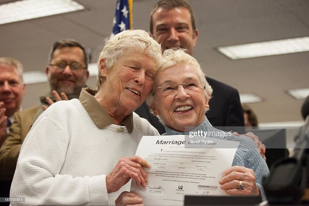 Jane Abbott Lighty, left, and Pete-e Petersen embrace after receiving the first same-sex marriage license in Washington state at the King County Recorder's Office on December 6, 2012 in Seattle, Washington. The office opened at 12:01 AM PST to begin issuing marriage licenses to same-sex couples for the first time after Washington voters chose to legalize same-sex marriage in November's election.