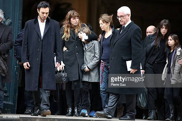 Jane Birkin daughters Lou Doillonand and Charlotte Gainsbourg attend the Tribute To Kate Barry At Eglise Saint Roch on December 19 2013 in Paris...