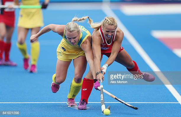 Jane Claxton of Australia and Kelsey Kolojejchick of USA during the FIH Women's Hockey Champions Trophy match between USA and Australia at Queen...