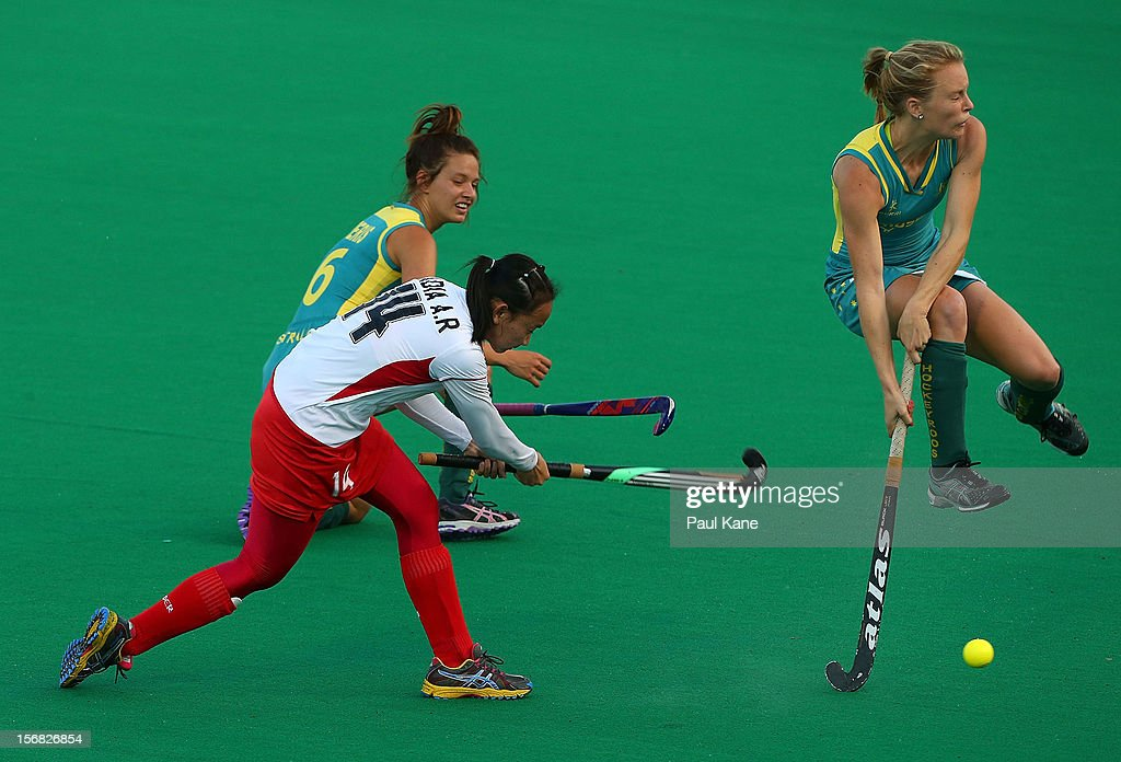 Jane Claxton of Australia jumps clear of a shot by Nadia Abd Rahman of Malaysia in the womens Australia under 21 v Malaysia game during day one of the 2012 International Super Series at Perth Hockey Stadium on November 22, 2012 in Perth, Australia.