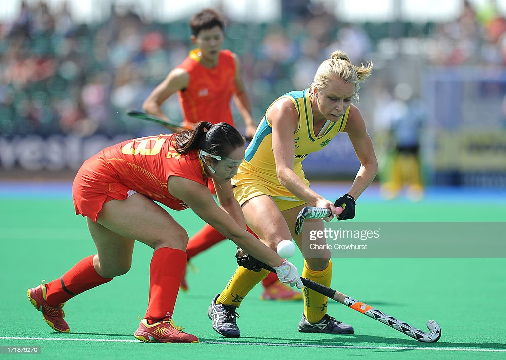Jane Claxton of Australia skips past Ren Ye of China during the Investec Hockey World League - Semi Finals match between China and Australia at The University of Westminster Sports Ground on June 29, 2013 in London, England.