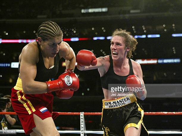 Jane Couch hits Lucia Rijker during their women's light welterweight bout at the Staples Center on June 21 2003 in Los Angeles California Lucia...