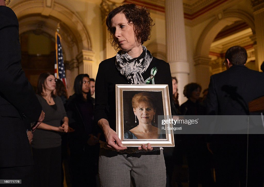 Jane Dougherty holds a photo of her sister, Mary Sherlach, who was killed at Sandy Hook, during a press conference to unveil gun legislation aimed at curbing gun violence, February, 04, 2013, at the Colorado State Capitol in Denver. Dougherty, who lives in Colorado, was joined by family members who lost loved ones in the Aurora theater shooting and at Columbine High School.