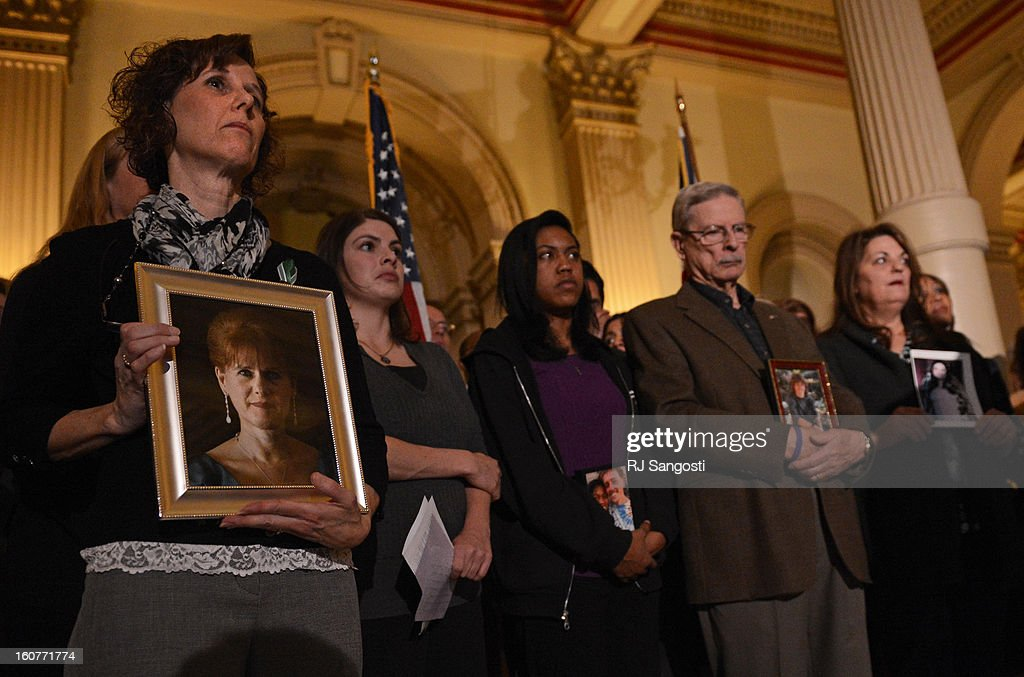 Jane Dougherty, left, holds a photo of her sister, Mary Sherlach, who was killed at Sandy Hook, during a press conference to unveil gun legislation aimed at curbing gun violence, February, 04, 2013, at the Colorado State Capitol in Denver. Dougherty, who lives in Colorado, was joined by family members who lost loved ones in the Aurora theater shooting and at Columbine High School.