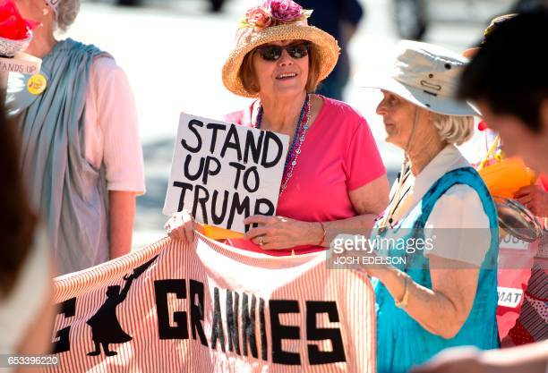 Jane Emery prepares to go on stage during Tech Stands Up rally against President Donald Trump in Palo Alto California on March 14 2017 / AFP PHOTO /...