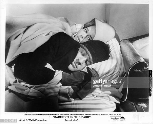 Jane Fonda and Robert Redford bundled up in bed together in a scene from the film 'Barefoot In The Park' 1967