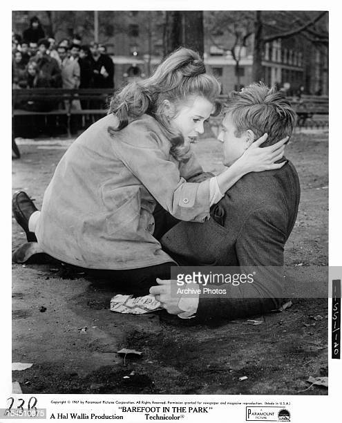Jane Fonda caressing a fallen Robert Redford in a scene from the film 'Barefoot In The Park' 1967