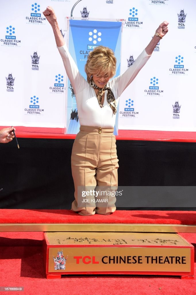 Jane Fonda celebrates during her Handprint/Footprint Ceremony during the 2013 TCM Classic Film Festival at TCL Chinese Theatre on April 27, 2013 in Los Angeles. Fonda is an American actress, writer, political activist, former fashion model, and fitness guru. She rose to fame in the 1960s with films such as Barbarella and Cat Ballou. She has won two Academy Awards, an Emmy Award, three Golden Globes and received several other movie awards and nominations during more than 50 years as an actress. After 15 years of retirement, she returned to film in 2005 with Monster-in-Law, followed by Georgia Rule two years later. She also produced and starred in over 20 exercise videos released between 1982 and 1995, and once again in 2010.