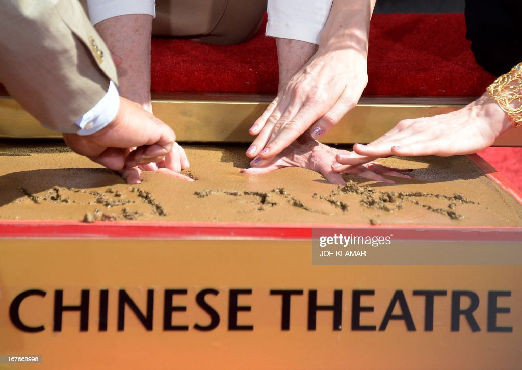 Jane Fonda prints her hands in wet cement during her Handprint/Footprint Ceremony during the 2013 TCM Classic Film Festival at TCL Chinese Theatre on April 27, 2013 in Los Angeles. Fonda is an American actress, writer, political activist, former fashion model, and fitness guru. She rose to fame in the 1960s with films such as Barbarella and Cat Ballou. She has won two Academy Awards, an Emmy Award, three Golden Globes and received several other movie awards and nominations during more than 50 years as an actress. After 15 years of retirement, she returned to film in 2005 with Monster-in-Law, followed by Georgia Rule two years later. She also produced and starred in over 20 exercise videos released between 1982 and 1995, and once again in 2010.