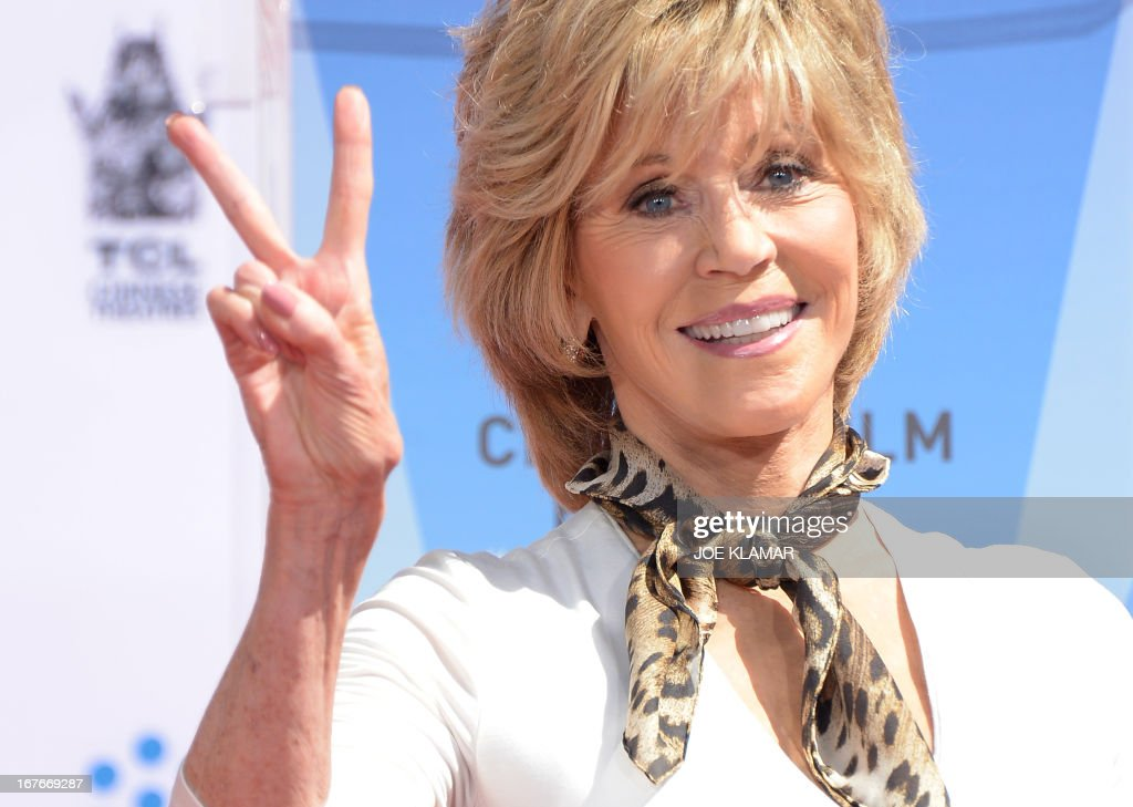 Jane Fonda shows V-sign during her Handprint/Footprint Ceremony during the 2013 TCM Classic Film Festival at TCL Chinese Theatre on April 27, 2013 in Los Angeles. Fonda is an American actress, writer, political activist, former fashion model, and fitness guru. She rose to fame in the 1960s with films such as Barbarella and Cat Ballou. She has won two Academy Awards, an Emmy Award, three Golden Globes and received several other movie awards and nominations during more than 50 years as an actress. After 15 years of retirement, she returned to film in 2005 with Monster-in-Law, followed by Georgia Rule two years later. She also produced and starred in over 20 exercise videos released between 1982 and 1995, and once again in 2010.