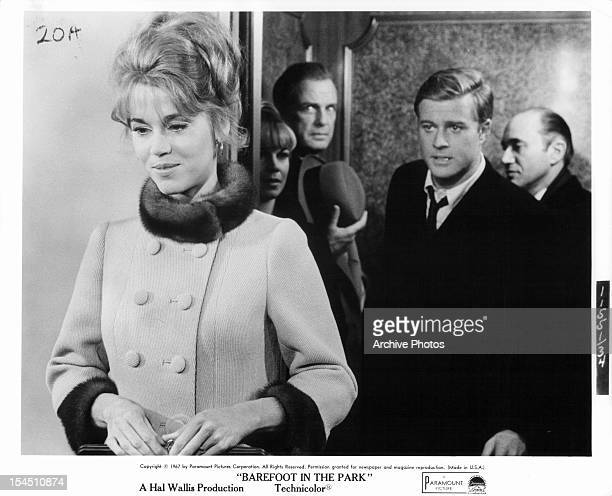 Jane Fonda standing before Robert Redford in a scene from the film 'Barefoot In The Park' 1967
