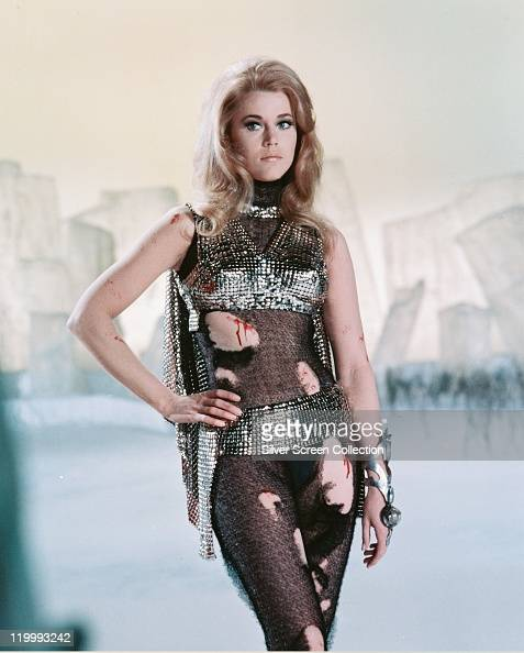 Jane Fonda US actress in costume with spots of blood on her arms torso and leg in a publicity portrait issued for the film 'Barbarella' 1968 The...