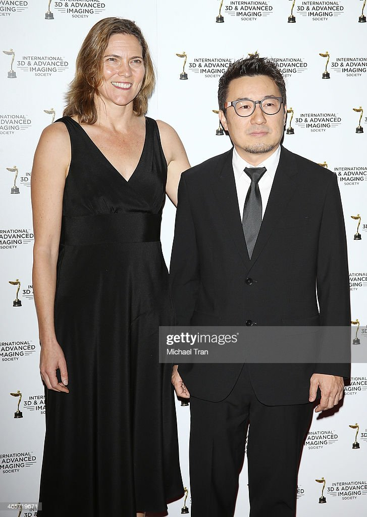 Jane Hartwell (L) and Yong Duk Jhun arrive at the 2014 International 3D and Advanced Imaging Society's Creative Arts Awards held at Steven J. Ross Theatre on January 28, 2014 in Burbank, California.