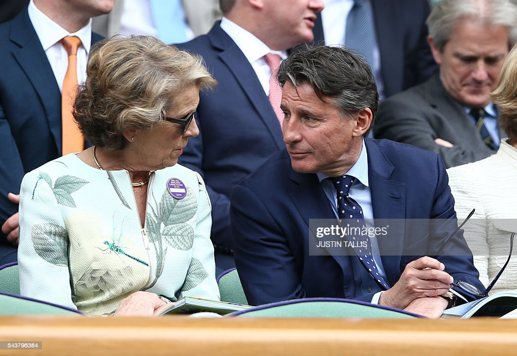 Jane Henman (L) speaks with Sebastien Coe on centre court to watch Japan's Kei Nishikori and France's Julien Benneteau during their men's singles second round match on the fourth day of the 2016 Wimbledon Championships at The All England Lawn Tennis Club in Wimbledon, southwest London, on June 30, 2016. / AFP / JUSTIN