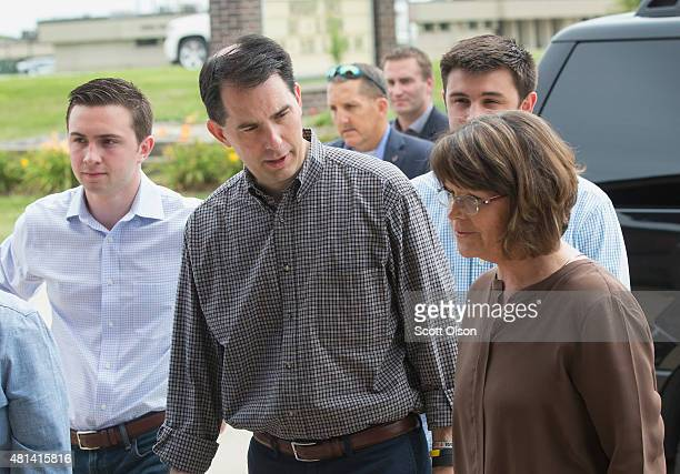Jane Jech greets Republican presidential hopeful Wisconsin Governor Scott Walker as he arrives for Sunday service with his family including sons Matt...
