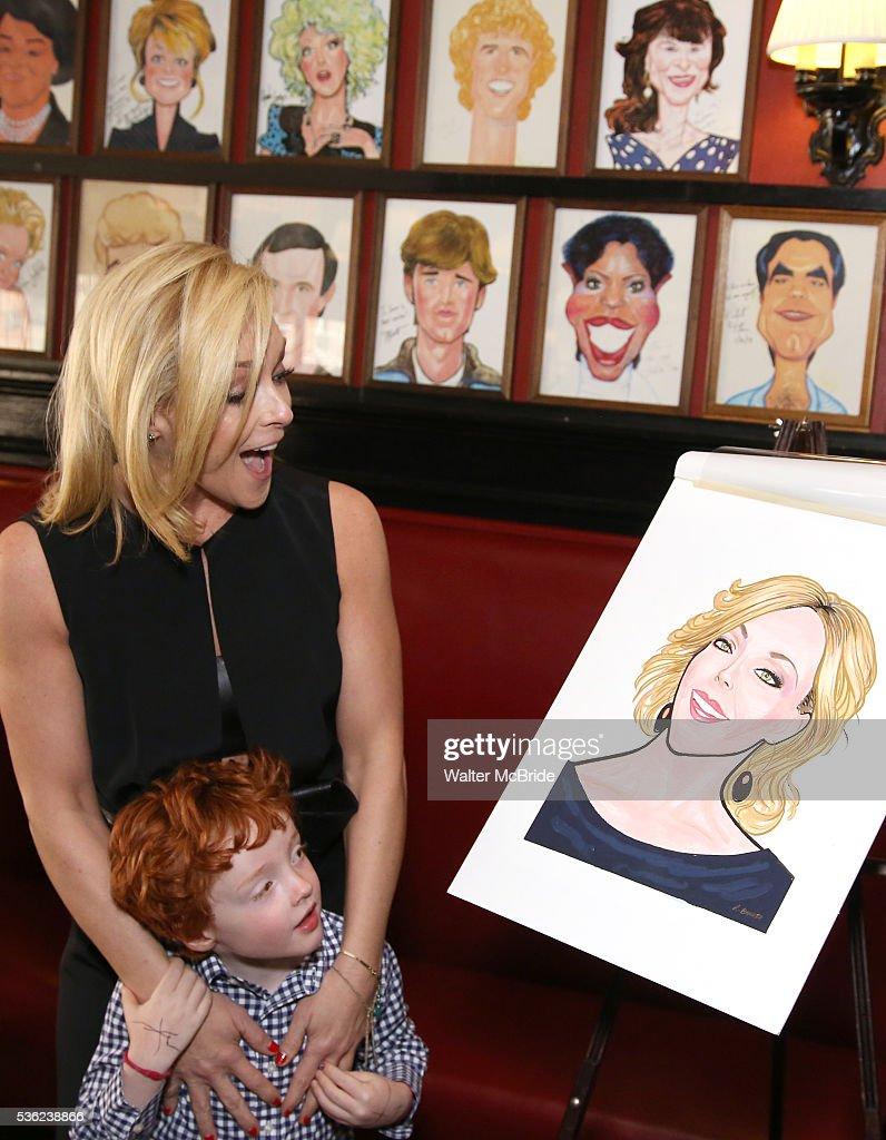 Jane Krakowski with son Bennett Robert Godley attend the Jane Krakowski Sardi's portrait unveiling at Sardi's on May 31, 2016 in New York City.