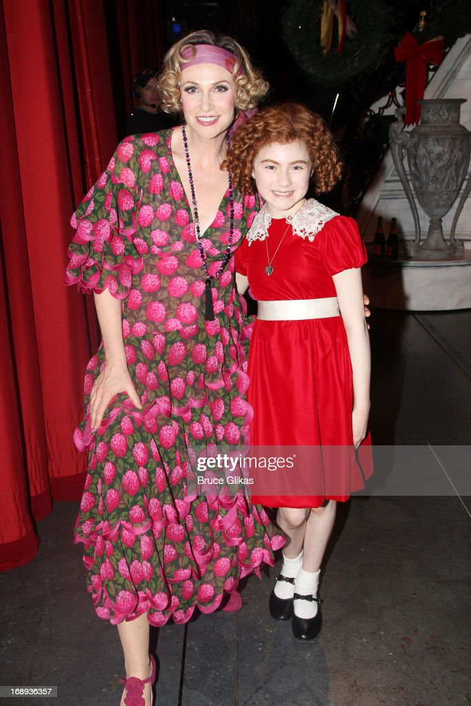 Jane Lynch as 'Miss Hannigan' and Lilla Crawford as 'Annie' pose backstage at Jane Lynch's opening night in Broadway's 'Annie' at The Palace Theater...