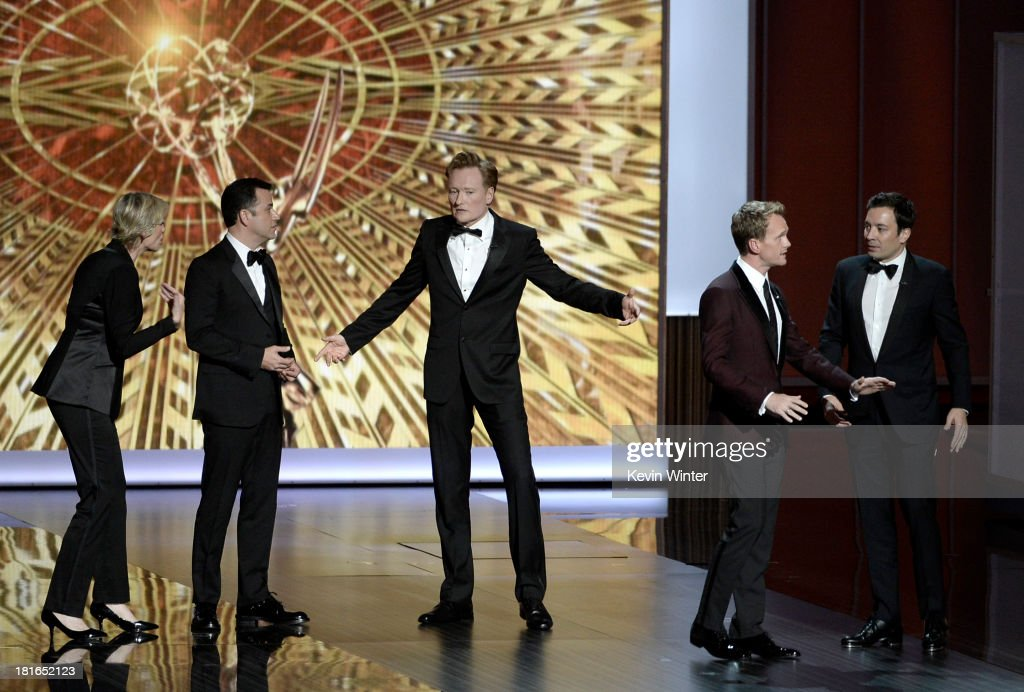 Jane Lynch, Jimmy Kimmel, Conan O'Brien, Jimmy Fallon and host Neil Patrick Harris onstage during the 65th Annual Primetime Emmy Awards held at Nokia Theatre L.A. Live on September 22, 2013 in Los Angeles, California.