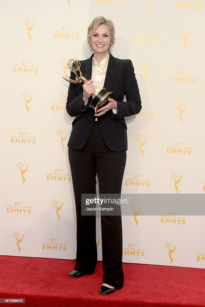 """Jane Lynch, winner of the outstanding host for a reality or reality competition program for her work on """"Hollywood Game Night"""" poses in the press room during the 2015 Creative Arts Emmy Awards at Microsoft Theater on September 12, 2015 in Los Angeles, California."""