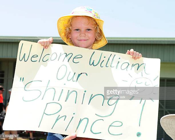 Jane Machan holds up a sign while waiting for HRH Prince William at the Cardwel Community Hall on March 19 2011 in Cardwell Australia His Royal...