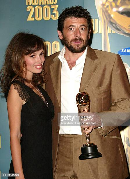 Jane March and Patrick Bruel during 2003 Monte Carlo World Music Awards Press Room at Monte Carlo Sporting Club in Monte Carlo Monaco