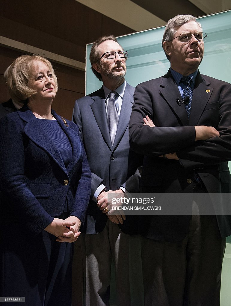 Jane Mitchell (L) and her husband Jeffrey Bland (C), donors of the Dom Pedro listen during an unveiling in the Janet Annenberg Hooker Hall of Geology, Gems and Minerals at the Smithsonian's National Museum of Natural History December 6, 2012 in Washington, DC. The Dom Pedro aquamarine, currently considered the largest single piece of cut gem aquamarine in the world, was donated to the Smithsonian by Jane Mitchell and her husband Jeffrey Bland. AFP PHOTO/Brendan SMIALOWSKI