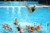 Jane Moran of Australia and team mates celebrate winning the Women's Water Polo Bronze Medal match between Australia and Hungary on Day 13 of the...