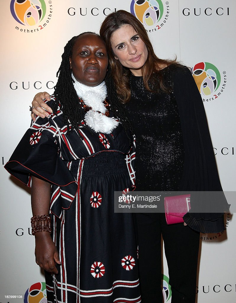 Jane Njoki Peris and Livia Firth attend the mothers2mothers cocktail party to celebrate reaching one million mothers in partnership with GUCCI at One Marylebone on October 3, 2013 in London, England.
