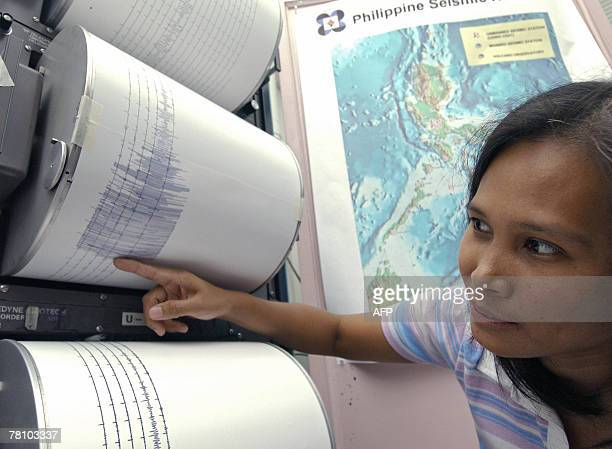 Jane Punongbayan supervising science research specialist officer of phivolcs points to the seismograph readings of the 60magnitude earthquake which...