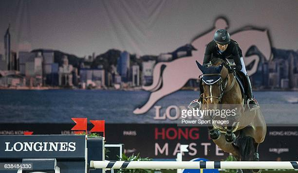 Jane Richard Philips of Switzerland on Pablo de Virton in action during the Hong Kong Jockey Club Trophy competition as part of the Longines Hong...