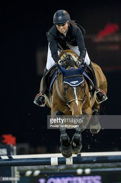 Jane Richard Philips of Switzerland rider Pablo de Virtont in action during the Longines Grand Prix as part of the Longines Hong Kong Masters on 15...