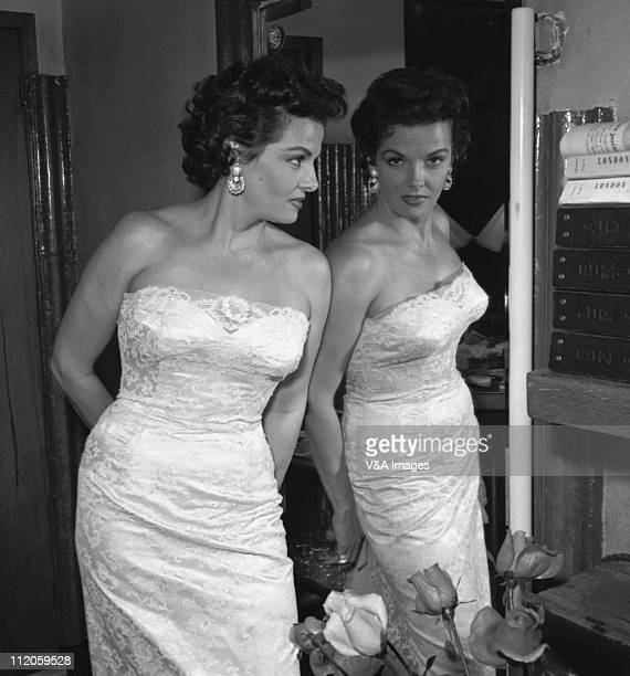 Jane Russell posed looking in mirror 1957